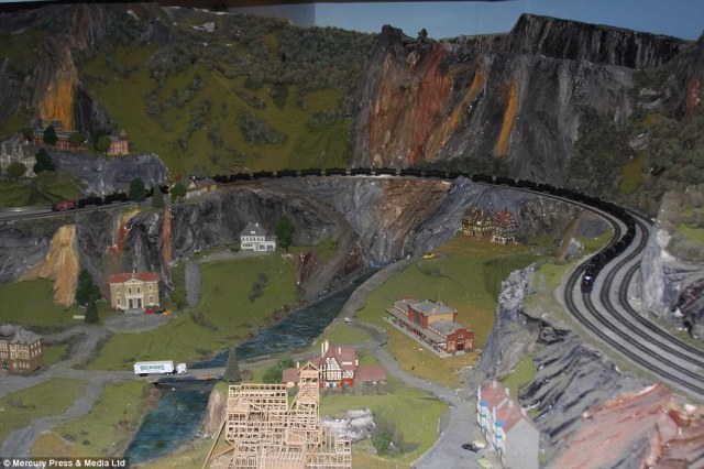 Some people say the model railway is better than the Grand Canyon according to Mr Zaccagnino who spent 16 years building the railway