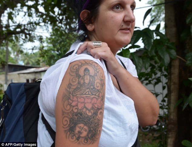 Tat's enough: Naomi Coleman, 37, was arrested at Bandaranaike International Airport in Sri Lanka for 'hurting religious feelings' with her sleeve depicting Buddha on a lotus flower