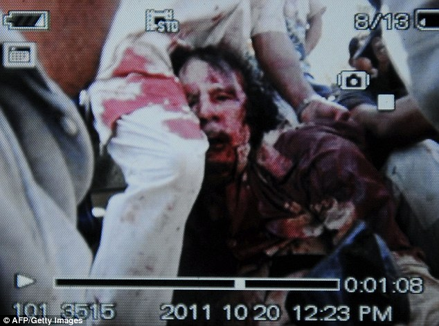 Killed: An image captured by a cellular phone camera shows the arrest of strongman Muammar Gaddafi in Sirte, Libya on October 20, 2011