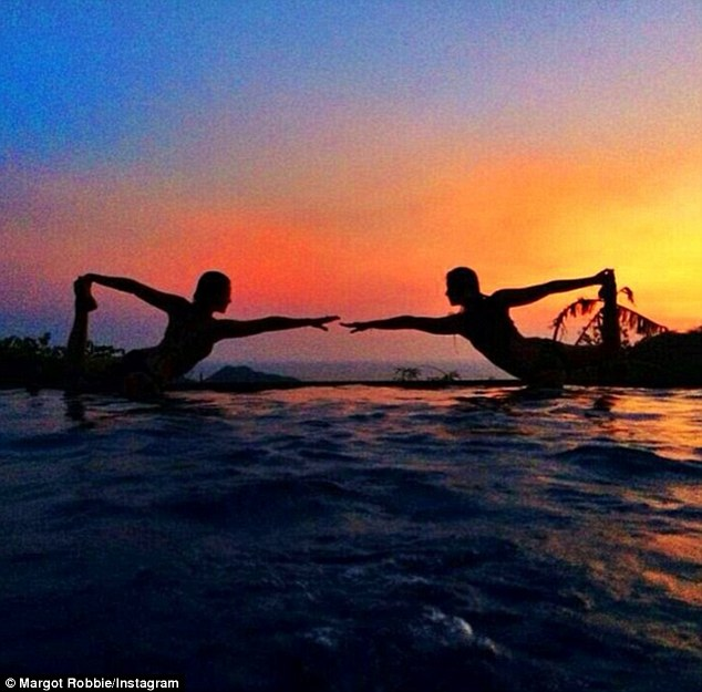 Salute the sun: The Wolf Of Wall Street actress and a friend practice yoga as the sun goes down on their tropical vacation