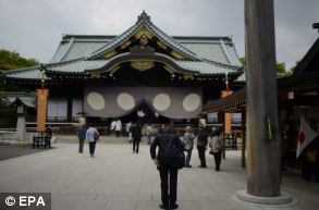 A visitor bows after he offered prayers at Yasukuni Shrine