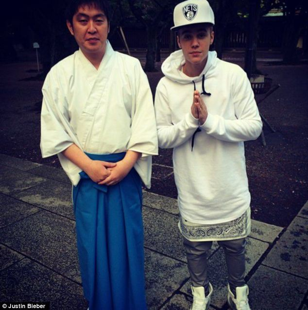 In bad taste: The Canadian pop star posted photos on his Instagram feed of the Yasukuni Shrine which commemorates Japan's 2.5 million war dead, including convicted war criminals