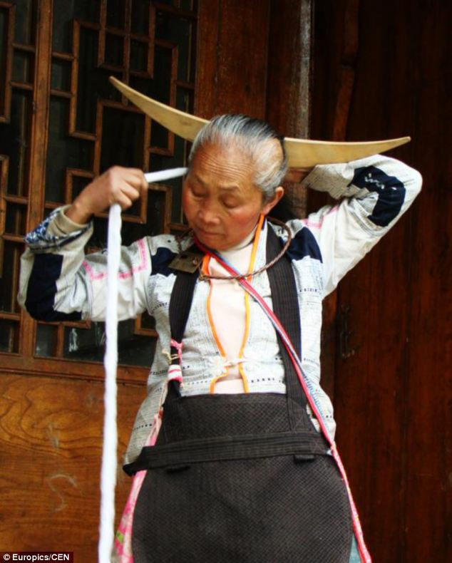 The tradition is believed to have originated with the wearing of the horns as the cow was a sacred animal in the past for people in this rural area, a Chinese expert in minority cultures has said