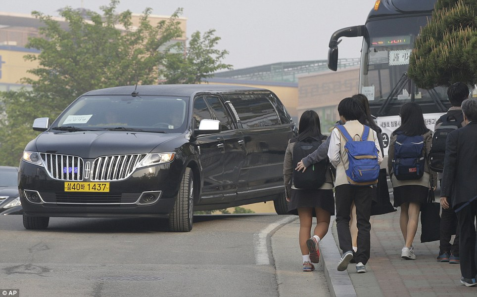 A hearse arrives carrying the body of a student. Pupils from Danwon High School in Ansan are seen returning to school following the tragedy which struck last week