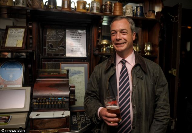 Still smiling: Nigel Farage is faring well in the polls ahead of the European elections next month