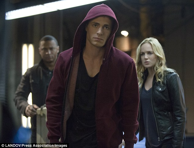 On set: David Ramsey (left) as John Diggle, Haynes as Roy Harper, and Caity Lotz as Canary in a scene from Arrow