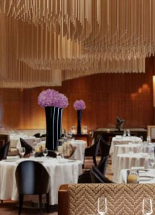 Amber in Hong Kong features a striking chandelier made of more than 400 bronze rods