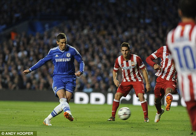 Goal-bound: Torres scores to give Chelsea the early 1-0 lead to the delight of the home fans
