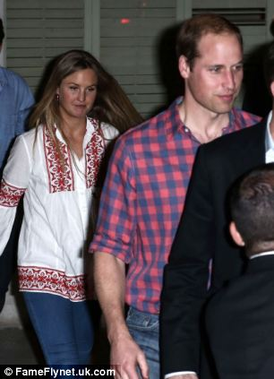 Wearing a country-style checkered shirt, William arrives for dinner with his entourage