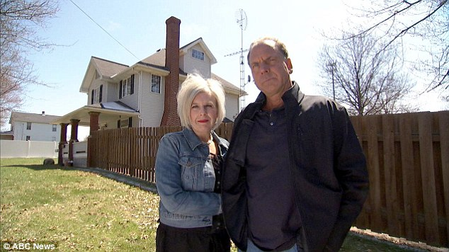 Complaining: Rick and Lucinda Krlich of East Liberty Street in Hubbard, Ohio (pictured) claim they've been stalked and harassed for seven years after trying to buy their neighbor's property (pictured left) in 2007