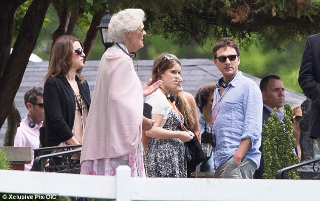 Princess Eugenie takes in the sights at Elvis Presley's Graceland in Memphis along with other members of the high-society wedding party. No doubt she was a bit tired from the Thursday night out beforehand