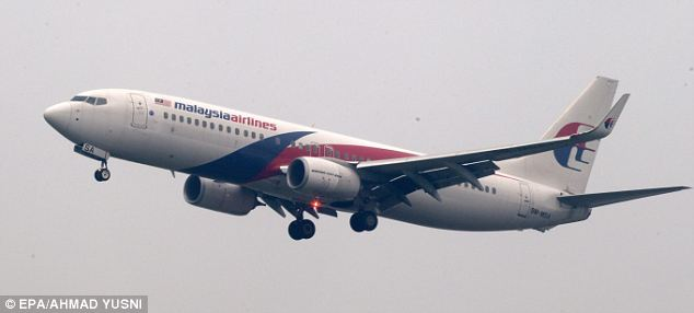 A Malaysian Airlines aircraft takes off from Kuala Lumpur Airport: Questions have been raised after the airline refused to reveal details of 2.3 tonnes of cargo aboard missing jet MH370 that was not listed on its manifest