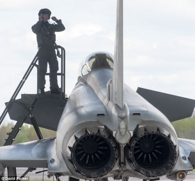 An RAF pilot prepares to board his Typhoon aircraft at the Siauliai Air Force base in Lithuania