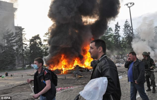 As the violence intensifies, Ukrainian nationalists set fire to a tent camp of pro-Russian activists