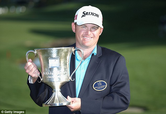 Winner: JB Holmes poses with the trophy after securing victory in the final round of the Wells Fargo Championship