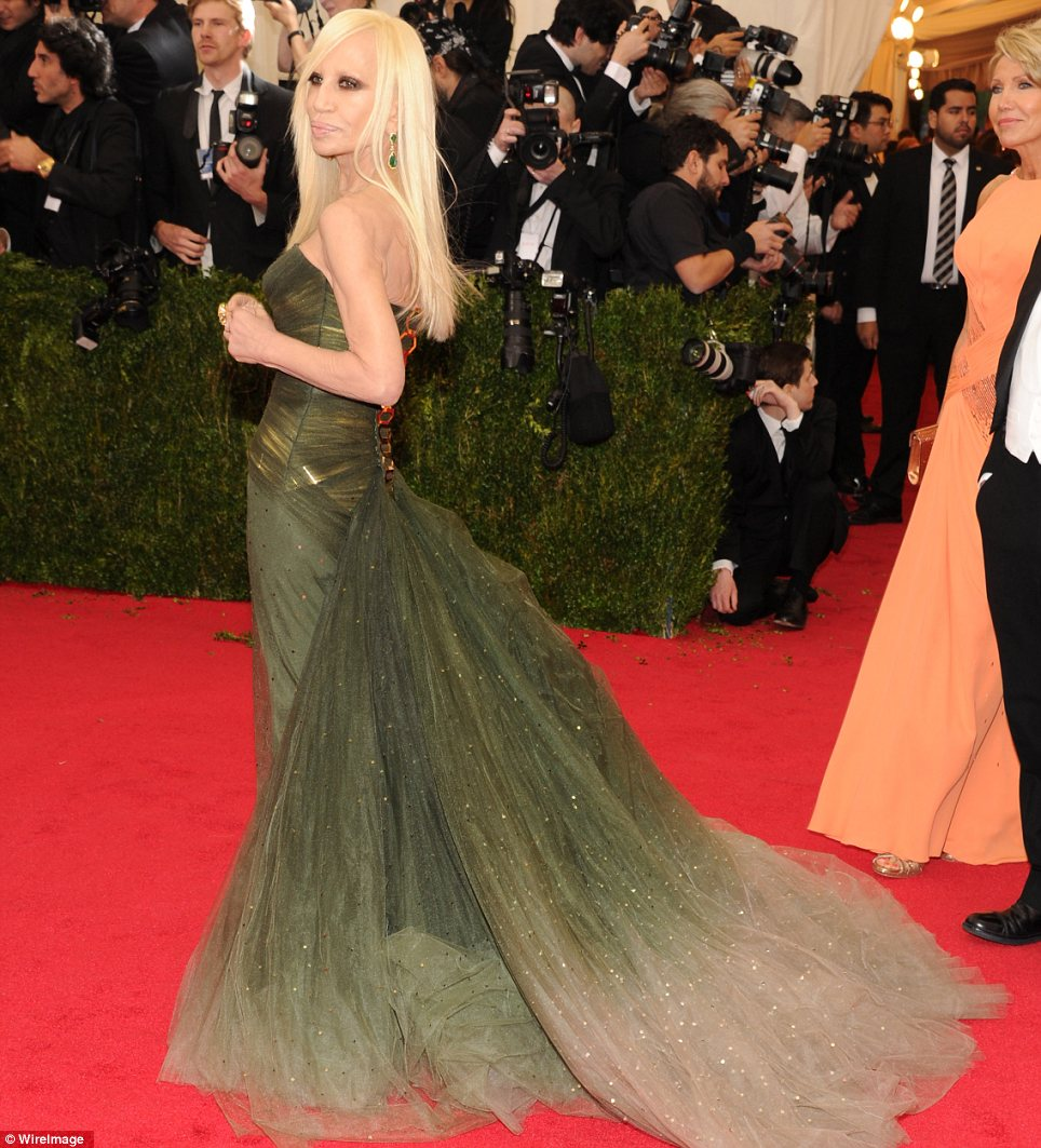 Like a nymph: Donatella Versace looked as though she was a woodland creature in her sparkling forest green gown