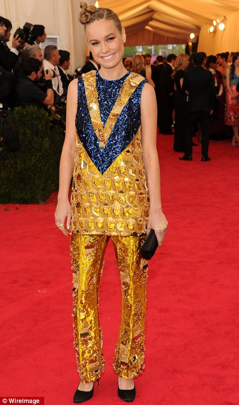 Sweet enough to eat: Julie Macklowe (L) wore a lemon yellow dress as Brie Larson stood out in amber sequins