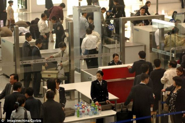 A long-haul queue: The technology's reliability and low false alarm rate significantly reduces the cost associated with delays, missed flights, confiscations and extra personnel required to manage current security processes (pictured), according to the Royal Academy of Engineering
