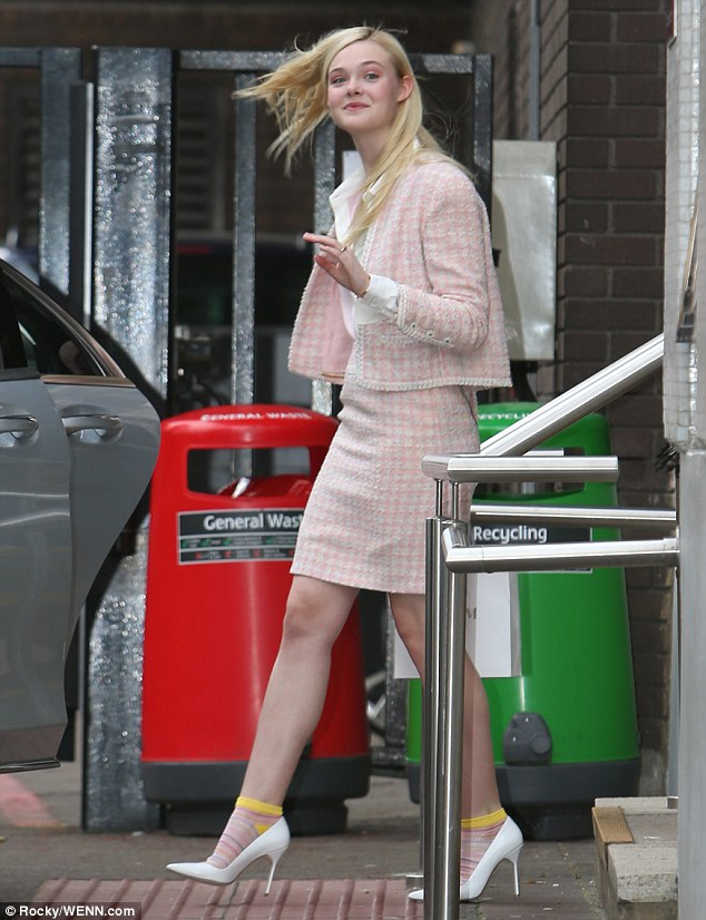 stylish sofa uk how to make a simple lego elle fanning sports demure pink skirt suit as she talks ...