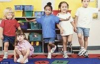 Carson City in California may start giving KINDERGARTNERS misdemeanors for bullying (library image of students pictured)