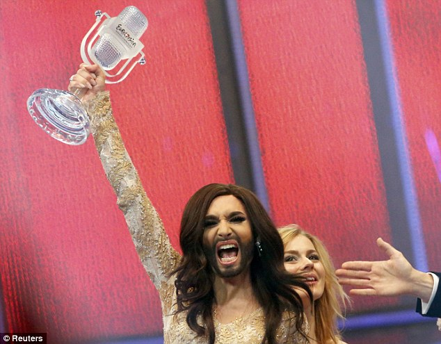 Triumphant: The drag queen declared 'we are unstoppable' as she celebrated winning the prize for Austria