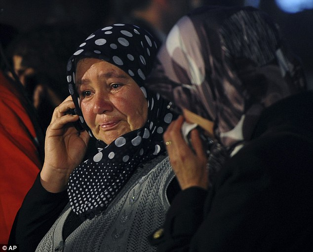 Emotional family members wait outside the coal mine