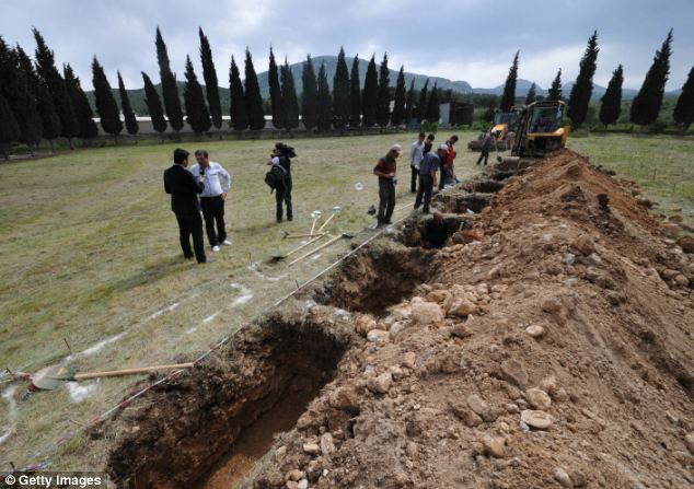 Tragic: Today, locals in Soma began digging graves for the hundreds of victims pulled out last night