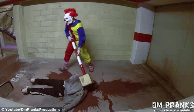 The clown is heard laughing hysterically as the fake person is left lying in a pool of blood in the car park