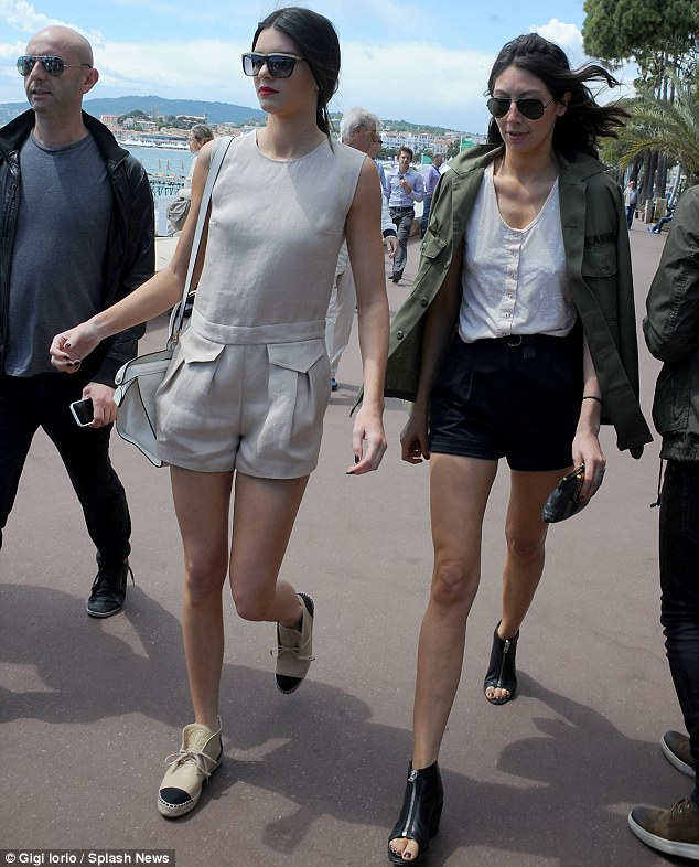 What a wardrobe! Kendall flashed her long pins as she walked with friends on the second day on the trip