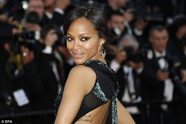 Sneaky: Zoe showed off an Arabic tattoo on her ribcage which trailed around her back