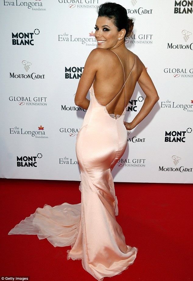 Looks familiar: Eva Longoria seemed to be copying Kim Kardashian when she did a derriere pose in this pale pink gown while on the carpet for the Global Gift Gala in Cannes on Friday