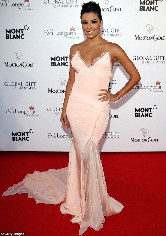 Belle of the ball: Eva was the host of the event which helped raise money for her charity