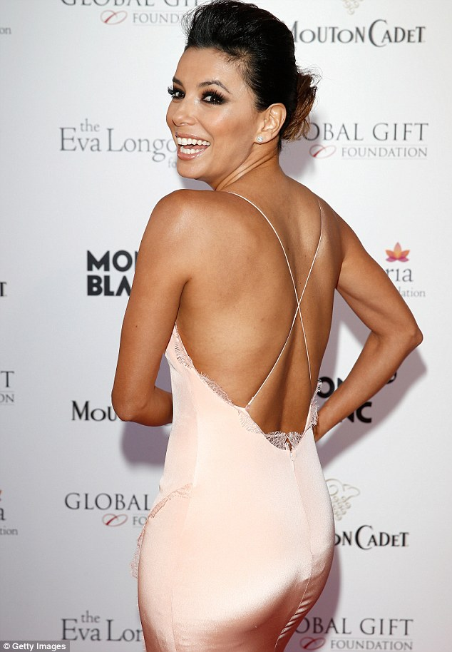 Stunning: The Desperate Housewives star showed off her toned back and pert derriere in the tight strapless number