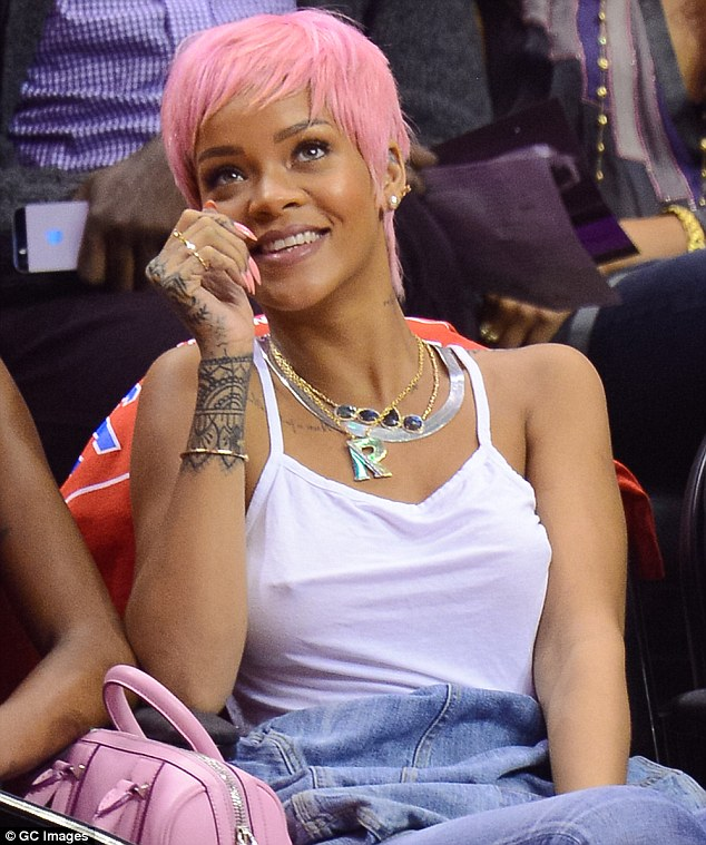Loving it: Barbadian beauty Rihanna has been a regular fixture at Clippers games in recent weeks