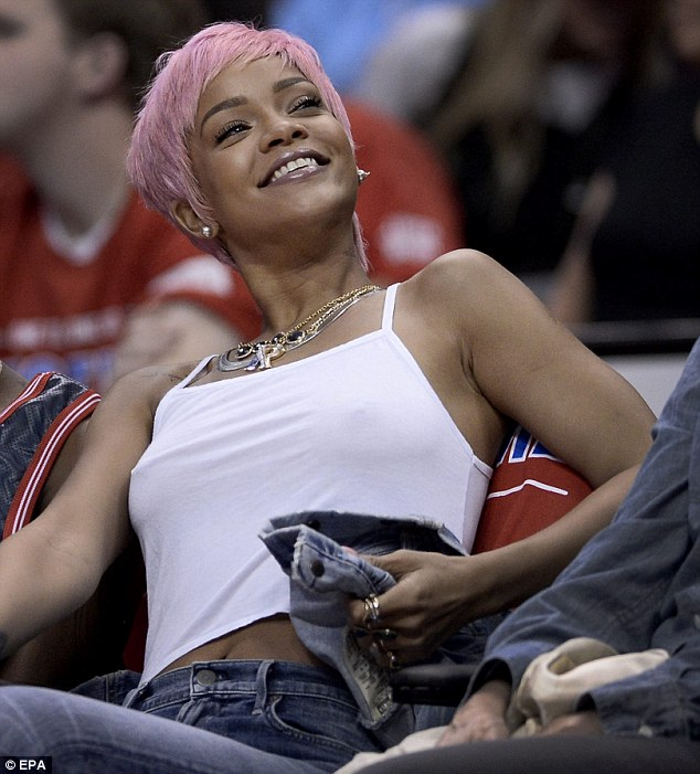 She's pleased: Despite the defeat Rihanna was in high spirits as she occupied her courtside seat
