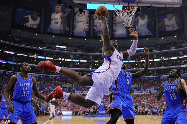Flying leap: Clippers forward Glen Davis (second left) shoots for the hoop as the Thunder watch on