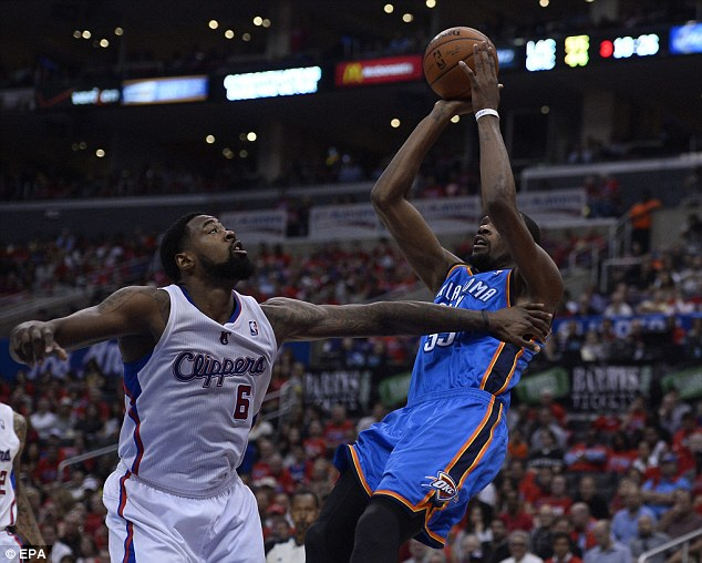 Foul play: Durant (right) is pushed as he shoots by DeAndre Jordan but the Thunder emerged unscathed