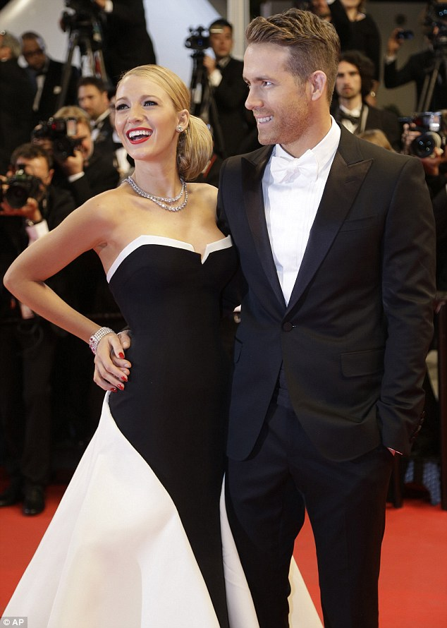 Hollywood's most glamorous couple? Ryan Reynolds and Blake Lively arrive for The Captive screening at Cannes Film Festival on Friday