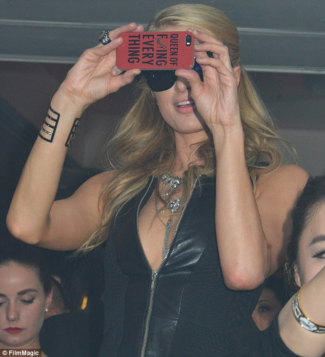 Confident: Paris was spotted with a 'Queen of f***ing everything' phone case on Thursday