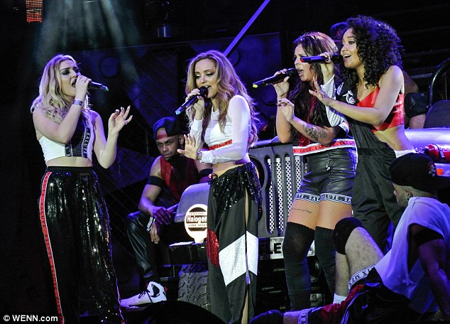 New look: The girls changed into an American style street party which at one point saw Jesy in a phone box