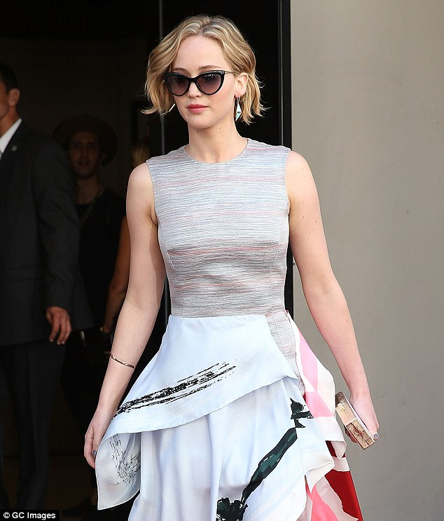 Stepping out: Jennifer leaves the Majestic Hotel in Cannes ahead of the photo-call on Saturday