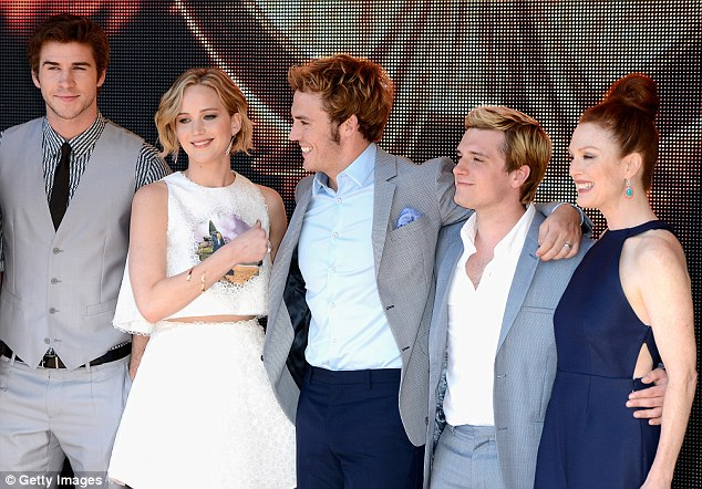 Plenty to smile about: The cast are looking ahead to success with the second of their three Hunger Games films