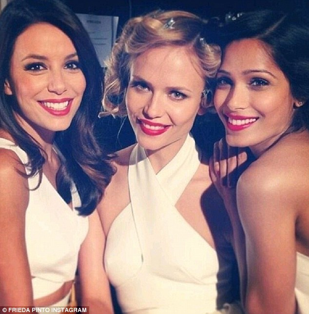 In the red: Freida shared a picture with Eva and Natasha earlier in the day while they were on a photoshoot