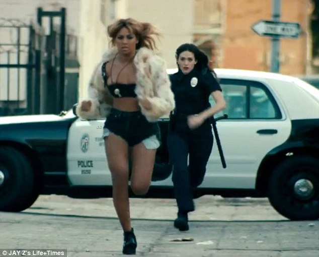 Stylish escape: The 32-year-old runs from the police wearing hot pants, a bra and fur