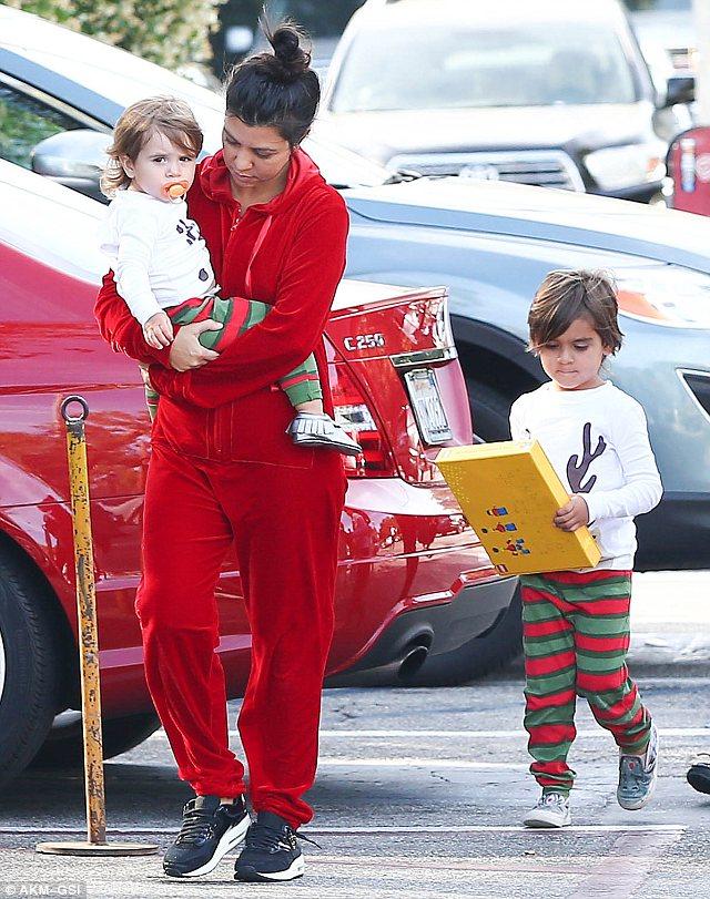 Kourtney Kardashian Wears Red Onesie And Messy Hair For