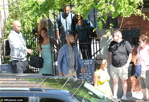 Group lunch: Jay-Z can be seen following wife Beyonce and their entourage, while Solange in yellow walks towards the car