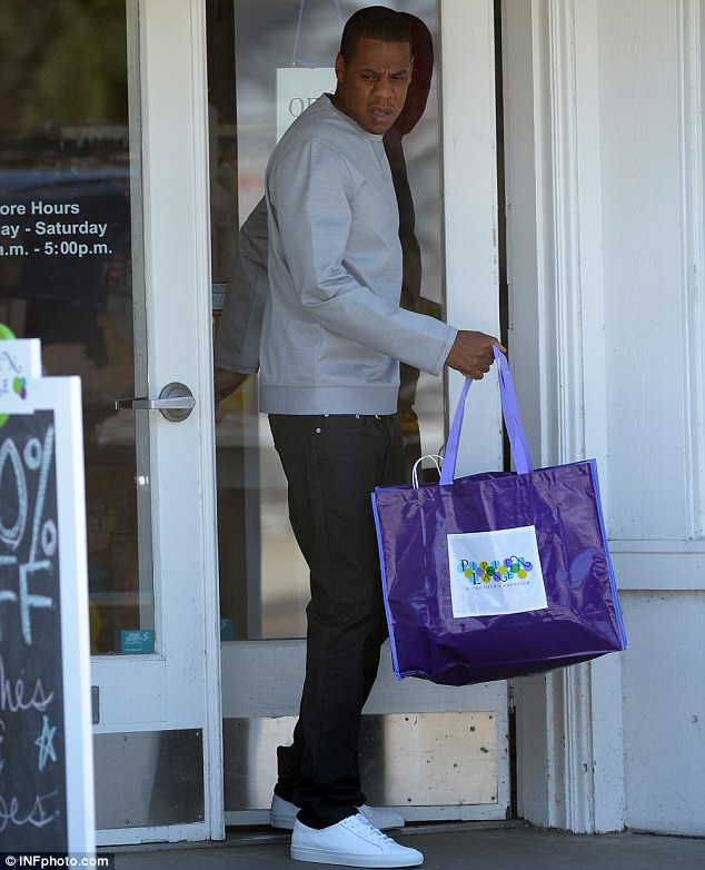 Shopping day: Jay-Z emerged from a children's store with a bag full of goodies for Blue