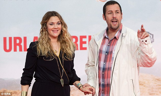 Together again: Drew Barrymore and Adam Sandler made the most of a red carpet appearance for the German premiere of their film Blended