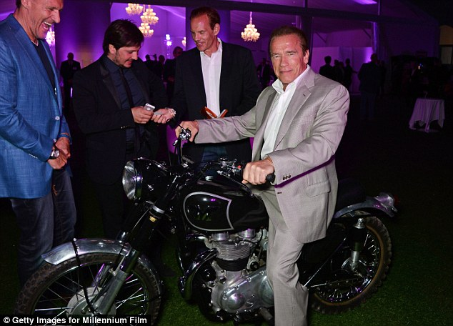 Let's ride! The former politician grinned while sitting on a motorcycle