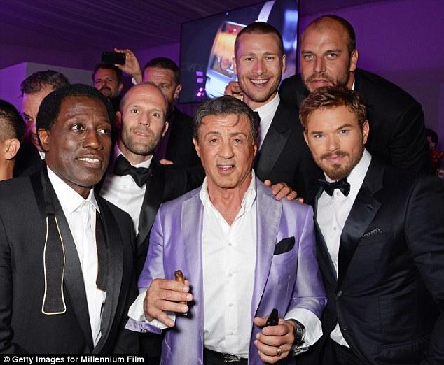 Guys gone wild! The Rocky star posed alongside Wesley Snipes, Jason Statham, Glen Powell, Patrick Hughes, and Kellan Lutz